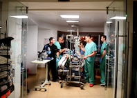 Team members from the 59th Medical Wing and the Army Institute of Surgical Research prepare a patient for transport from a hospital in South America to the San Antonio Military Medical Center in Texas, Feb. 16, 2017. The members of the medical team are part of the Defense Department's only extracorporeal membrane oxygenation transport program run by the 59th Medical Wing. (U.S. Air Force photo/Staff Sgt. Jerilyn Quintanilla)