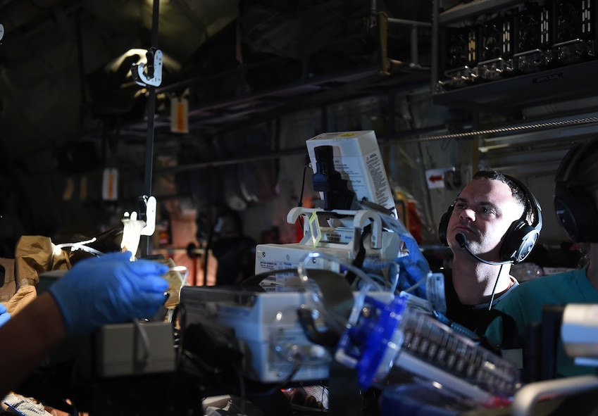U.S. Air Force 1st Lt. Joseph Acquafredda, a 59th Medical Wing extracorporeal membrane oxygenation specialist, monitors the patient during flight on board a C-130J Super Hercules, Feb. 16, 2017. Acquafredda was part of a 9-person medical team tasked to transport a critically-ill patient from South America back to the U.S. for care at the San Antonio Military Medical Center in San Antonio, Texas. (U.S. Air Force photo/Staff Sgt. Jerilyn Quintanilla)
