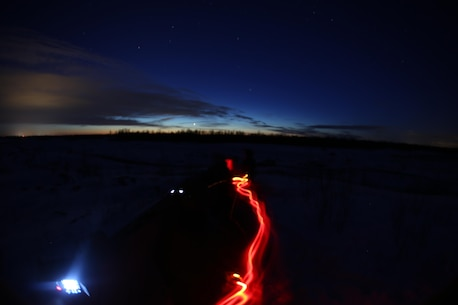 A Marine with a headlamp paces back and forth as he waits to radio in air support during close air support training operations at a range near Fort Drum, N.Y., March 16, 2017. Marines assigned to 1st Air Naval Gunfire Liaison Company, I Marine Expeditionary Force Headquarters Group, I Marine Expeditionary Force, worked in conjunction with Marines assigned to Marine Light Attack Helicopter Squadron 269, Marine Aircraft Group 29, 2nd Marine Aircraft Wing, to complete the training. Without the teamwork between Marines on the ground and Marines in the skies, pilots would have much more difficulty finding their mission objectives. (U.S. Marine Corps photo by Cpl. Mackenzie Gibson/Released)