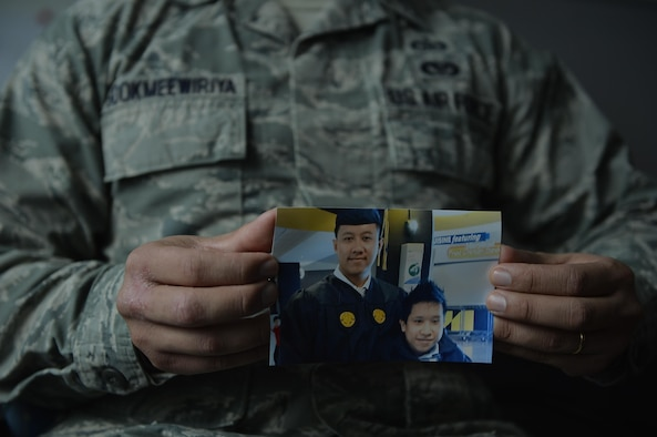 Staff Sgt. Srun Sookmeewiriya, 313th Expeditionary Operations Support Squadron NCO in charge of reports, holds up a picture of him and his younger brother, Thana, on Ramstein Air Base, Germany, Feb. 16, 2017. Sookmeewiriya, who attempted to commit suicide twice, draws inspiration from his brother to remain resilient and encourages Airmen to open up about their struggles.
