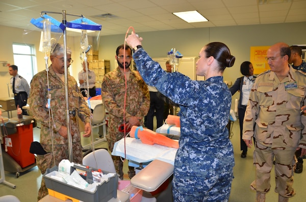 "Participants in the CENTCOM Theater Medical Conference tour the ""dead stick lab"", which is a laboratory used in the Basic Medical Technician Corpsman Program, where students practice intravenous (IV) and venipuncture skills on simulated arms. Medical professionals representing more than 10 countries within the US Central Command area of operation, Europe, and the U.S. attended the conference to aid in the continued development of capabilities that will serve to improve regional interoperability and cooperation. (Medical Education and Training Campus Public Affairs photo by Lisa Braun/Released)"