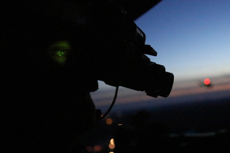 Cpl. Landon Cheek uses his night vision goggles to keep watch out the back of a UH-1Y Venom during night-time cold weather operations aboard Fort Drum, N.Y., March 17, 2017. Marines assigned to Marine Light Attack Helicopter Squadron 269, Marine Aircraft Group 29, 2nd Marine Aircraft Wing, conducted close air support at night with live ordnance to simulate real world operations in a forward position. Cheek is a crew chief with HMLA-269. (U.S. Marine Corps photo by Cpl. Mackenzie Gibson/Released)