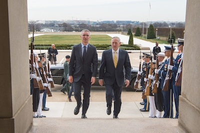 Defense Secretary Jim Mattis, right, walks with NATO Secretary General Jens Stoltenberg before a meeting at the Pentagon, March 21, 2017. DoD photo by Army Sgt. Amber I. Smith