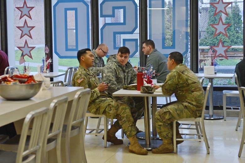 Airmen and Soldiers assigned to Joint Base Lewis-McChord, Wash., eat lunch at the United Service Organizations Northwest Shali Center Mar. 21, 2017 at JBLM. The USO Northwest has been servicing the surrounding area since 1966 and continues to serve the men and women of JBLM today. (U.S. Air Force/Senior Airman Divine Cox)