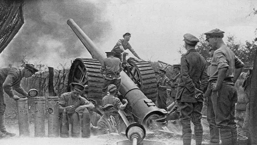 British soldiers prepare artillery shells and man a gun during World War I. Library of Congress photo