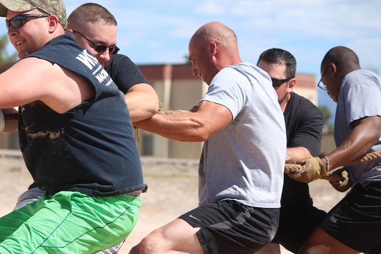 Airmen play a game of Tug-of-War during the 49th Wing Sports Day, March 17, 2017 at Holloman Air Force Base, N.M. During Sports Day, squadrons showed their pride and camaraderie during sports such as football, ultimate Frisbee, softball and many more. (U.S. Air Force photo by Airman 1st Class Ilyana Escalona)