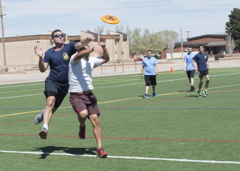 Airmen play a game of ultimate Frisbee during the 49th Wing Sports Day, March 17, 2017 at Holloman Air Force Base, N.M. During Sports Day, squadrons showed their pride and camaraderie during sports such as football, ultimate Frisbee, softball and many more. (U.S. Air Force photo by Senior Airman Emily Kenney)