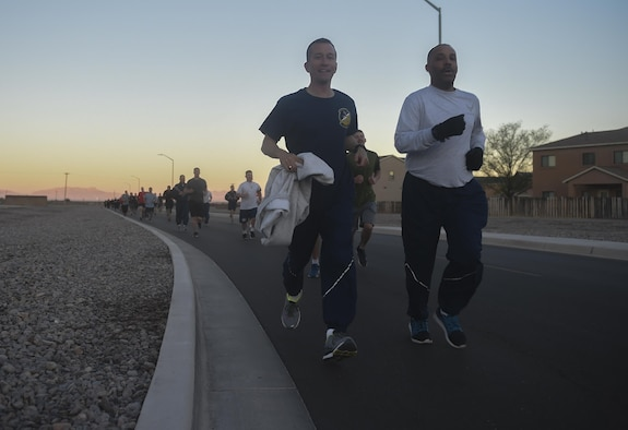 Col. Houston Cantwell, the 49th Wing commander, and Chief Master Sgt. Barrington Bartlett, the 49th Wing command chief, lead Airmen during a 5K run, March 17, 2017 at Holloman Air Force Base, N.M. The run was the first event for the 49th Wing Sports Day. Participants had the option to run either a 1.5 mile route or a 5K route. (U.S. Air Force photo by Staff Sgt. Eboni Prince)