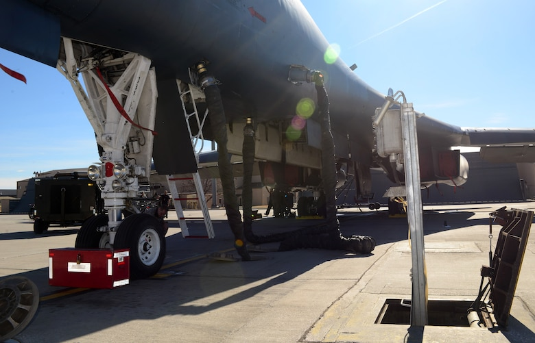 A B-1 bomber is hooked up to the Consolidated Aircraft Support System at Ellsworth Air Force Base, S.D., March 16, 2017. The CASS is made up of multiple structures and parts beneath the flight line used to provide both air and power to support the B-1 during pre-flight inspections. (U.S. Air Force photo by Airman 1st Class Donald C. Knechtel)