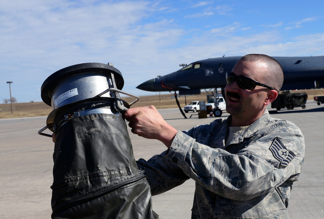 Tech. Sgt. Caleb Warren, an aerospace ground equipment craftsman assigned to the 28th Maintenance Squadron, holds up a Consolidated Aircraft Support System air valve at Ellsworth Air Force Base, S.D., March 16, 2017. Over the course of the last 10 years the 28th Civil Engineer Squadron and 28th MXS have put more than $500,000 worth of modifications into CASS in order to keep it running. (U.S. Air Force photo by Airman 1st Class Donald C. Knechtel)