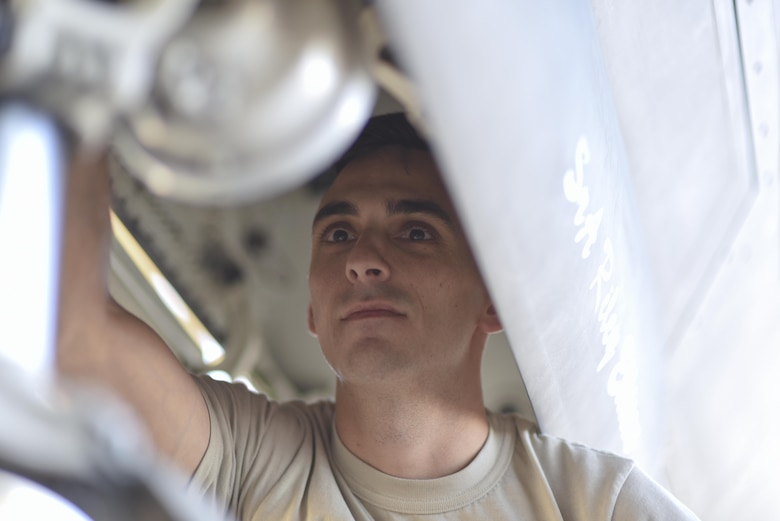 U.S. Air Force Tech. Sgt. Robert Mackle, 325th Aircraft Maintenance Squadron dedicated crew chief, inspects the housing of the front facing light of a F-22 Raptor on the Tyndall Air Force Base, Fla., flightline March 19, 2017. Mackle recently won the Chief Master Sergeant of the Air Force Thomas N. Barnes Crew Chief of the Year Award during the 325th Maintenance Group's Maintenance Professional of the Year Award ceremony that was hosted Feb. 17, 2017. (U.S. Air Force photo by Senior Airman Solomon Cook/Released)