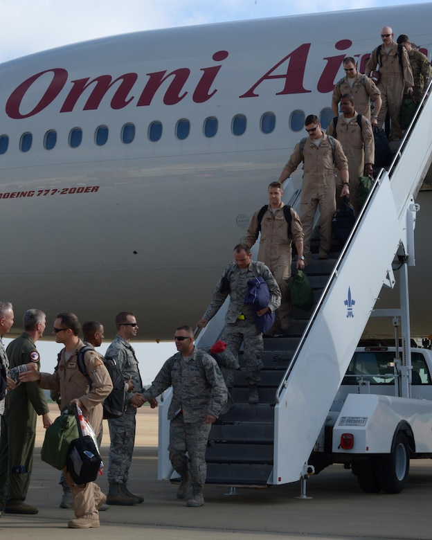 Members of Team Barksdale welcome home Airmen upon their return from deployment at Barksdale Air Force Base, La., March 21, 2017. Barksdale Airmen joined U.S. Air Forces Central Command in the mission to defeat and ultimately destroy ISIS through mutual support of regional forces. Since September 2016, Barksdale B-52 Stratofortresses and Airmen have flown over 400 sorties, dropped more than 2,500 weapons totaling approximately two million pounds, and executed more than 2,000 strikes against ISIS. (U.S. Air Force photo/Senior Airman Curt Beach)