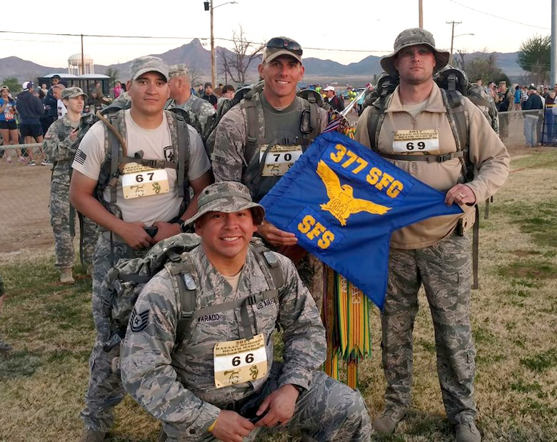 Tech. Sgt. Guillermo Castellano, Staff Sgt. Tanner Theel, Master Sgt. Seth Stockwell and Tech. Sgt. Felipe Alvarado, 377th Security Force Group, get ready to participate in the Bataan Memorial Death March, a 26-mile march through the high desert terrain of the White Sands Missile Range, N.M. The memorial march is conducted in honor of the heroic service members who defended the Philippine Islands during World War II, sacrificing their freedom, health, and, in many cases, their very lives. (U.S. Air Force Photo/Senior Airman Chandler Baker)