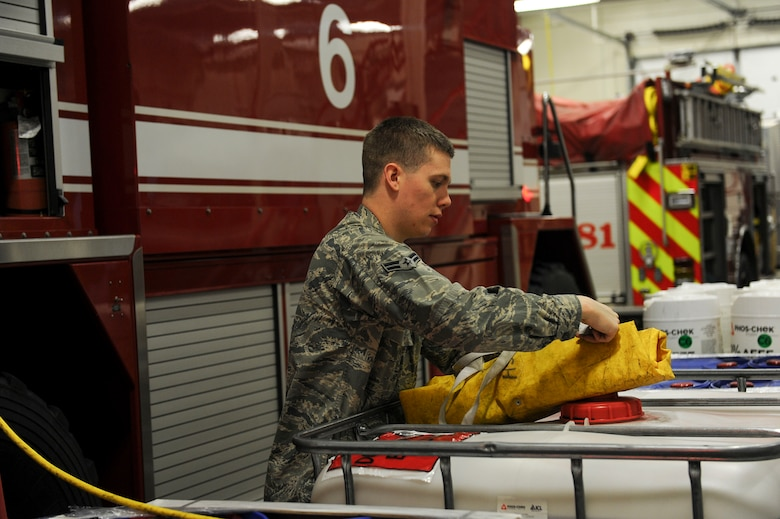 U.S. Air Force Airman 1st Class Sean Whittaker, a 354th Civil Engineer Squadron firefighter, inspects equipment March 13, 2017, at Eielson Air Force Base, Alaska. At the beginning of each shift firemen are responsible for checking their equipment to ensure it functions properly. (U.S. Air Force photo by Airman 1st Class Isaac Johnson)