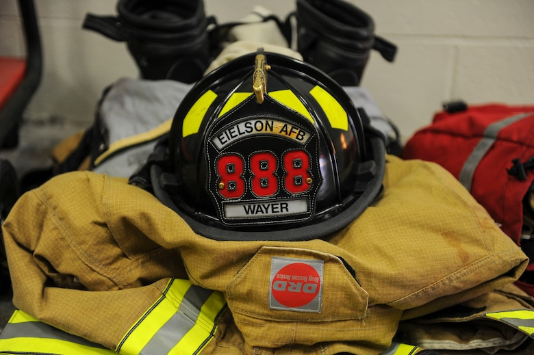 Equipment belonging to a U.S. Air Force firefighter from the 354th Civil Engineer Squadron, rests on the floor March 13, 2017, at Eielson Air Force Base, Alaska. Eielson firefighters support the communities fire and emergency services by lending them manpower and equipment. (U.S. Air Force photo by Airman 1st Class Isaac Johnson)