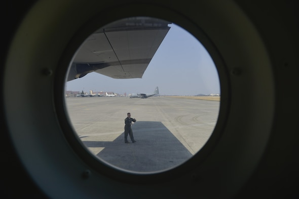 Staff Sgt. Benjamin Baughman, 36th Airlift Squadron loadmaster instructor, wraps ground wire around his arm prior to flight in a C-130J Super Hercules at Yokota Air Base, Japan, March 20, 2017. In case the aircraft is hit by lightning, the ground wire provides a conducting path towards the earth allowing the aircraft not to be effected by the electrical current. (U.S. Air Force photo by Staff Sgt. David Owsianka)