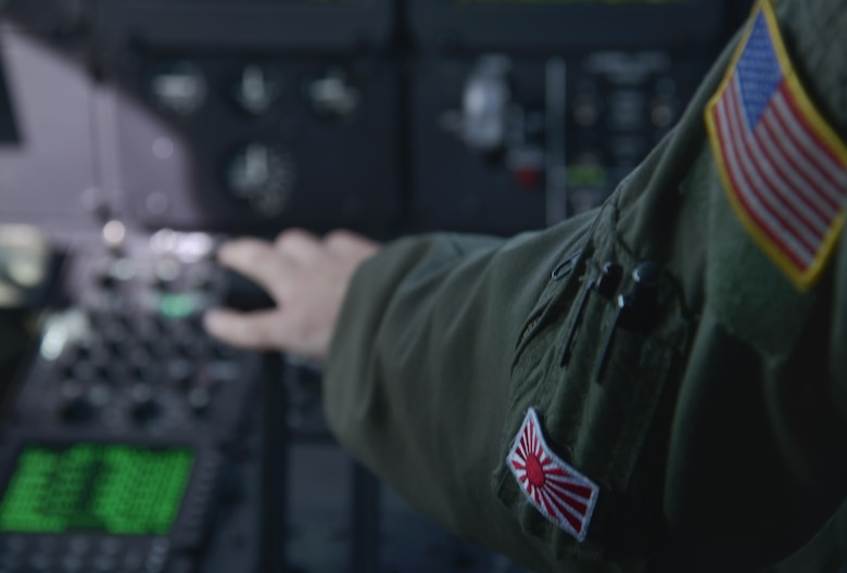 Maj. Jesse Klaetsch, 36th Airlift Squadron pilot, pushes down on the throttle while flying the first Yokota C-130J Super Hercules training sortie over the skies of Japan March 20, 2017. Compared to older C-130s, the J model climbs faster and higher, flies farther at a higher cruise speed, and takes off and lands in a shorter distance. (U.S. Air Force photo by Staff Sgt. David Owsianka)