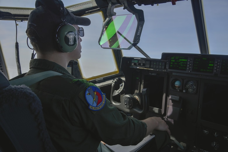 Capt. Chase Hessman, 36th Airlift Squadron pilot, looks at the heads up display during the first Yokota C-130J Super Hercules training sortie over the skies of Japan March 20, 2017. The display allows the pilots to view information such as altitude and airspeed while continuing to focus on flying. (U.S. Air Force photo by Staff Sgt. David Owsianka)