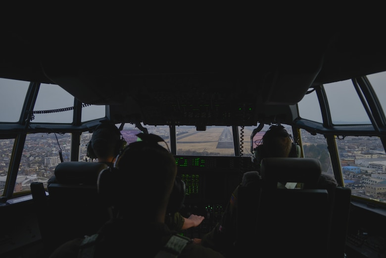 Crew members of the 36th Airlift Squadron approach the runway at Yokota Air Base, Japan, during the first Yokota C-130J Super Hercules training sortie March 20, 2017. The C-130J incorporates state-of-the-art technology to reduce manpower requirements, lower operating and support costs, and provide life-cycle cost savings over earlier C-130 models. (U.S. Air Force photo by Staff Sgt. David Owsianka)