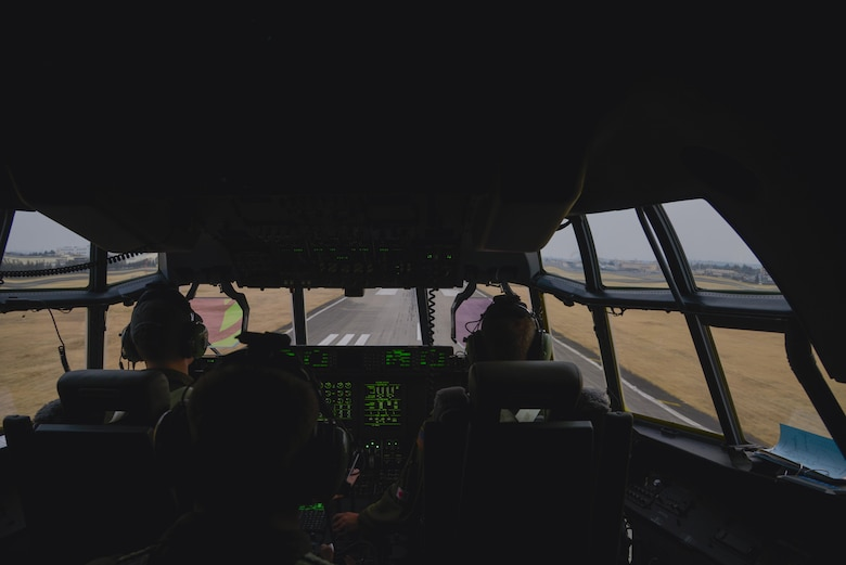Crew members of the 36th Airlift Squadron prepare to land at Yokota Air Base, Japan, during the first Yokota C-130J Super Hercules training sortie March 20, 2017. The pilots performed multiple touch and go training scenarios at Misawa and Yokota Air Base, Japan. (U.S. Air Force photo by Staff Sgt. David Owsianka)