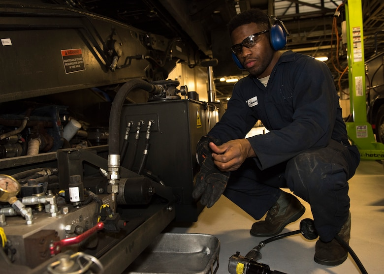 Senior Airman Brandon Johnson, 92nd Logistic Readiness Squadron Vehicle Maintenance journeyman, pauses working on a heavy aircraft loading vehicle March 20, 2017, at Fairchild Air Force Base, Wash. Johnson is a four-time team member of the United States Air Force wrestling team. (U.S. Air Force photo/Airman 1st Class Ryan Lackey)