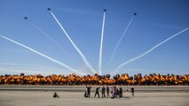 "The Patriots Jet Team performs aerial acrobatics as pyrotechnics provided by the Tora Bomb Squad of the Commemorative Air Force explode, forming a ""Wall Of Fire"" during the 2017 Yuma Airshow at Marine Corps Air Station Yuma, Ariz., Saturday, March 18, 2017. The airshow served as an opportunity for MCAS Yuma to thank the local community for their continued support."