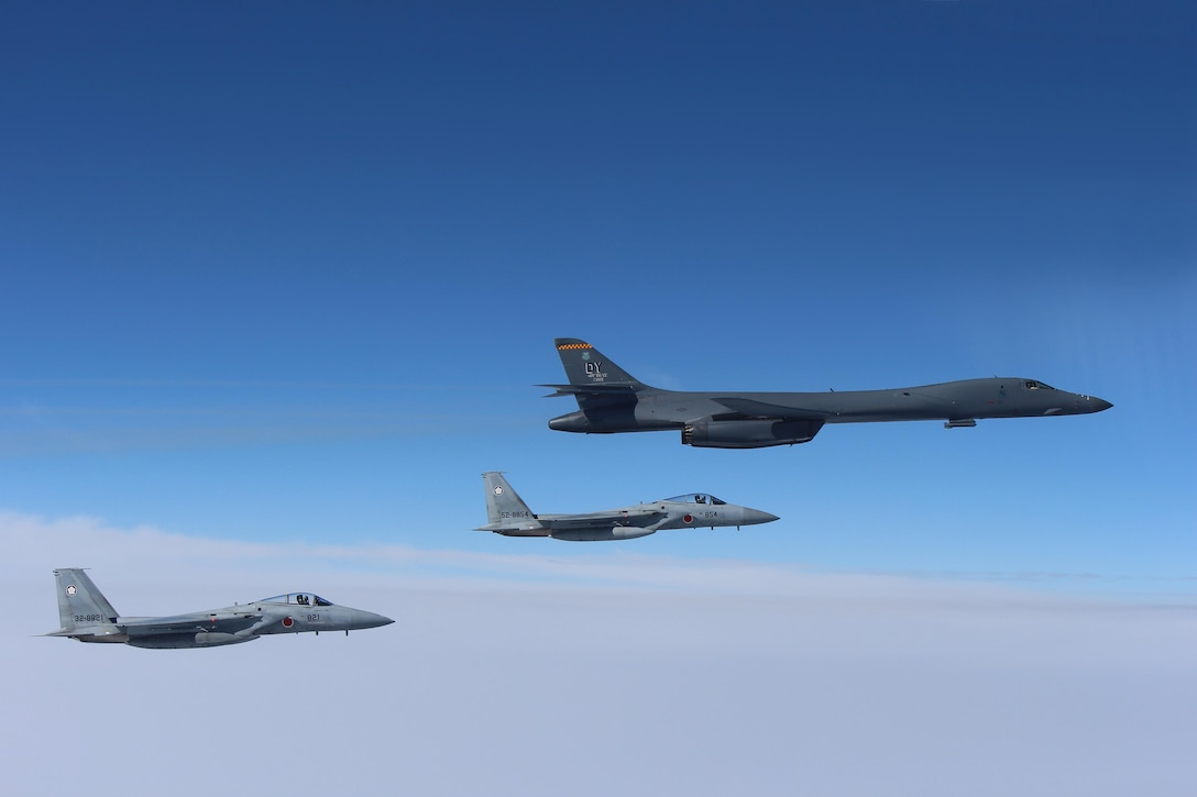 A U.S. Air Force B-1B Lancer flies in formation with Japan Air Self Defense Force F-15s in the vicinity of Japan March 21, 2017. The sortie was carried out as part of U.S. Pacific Command's continuous bomber presence mission.