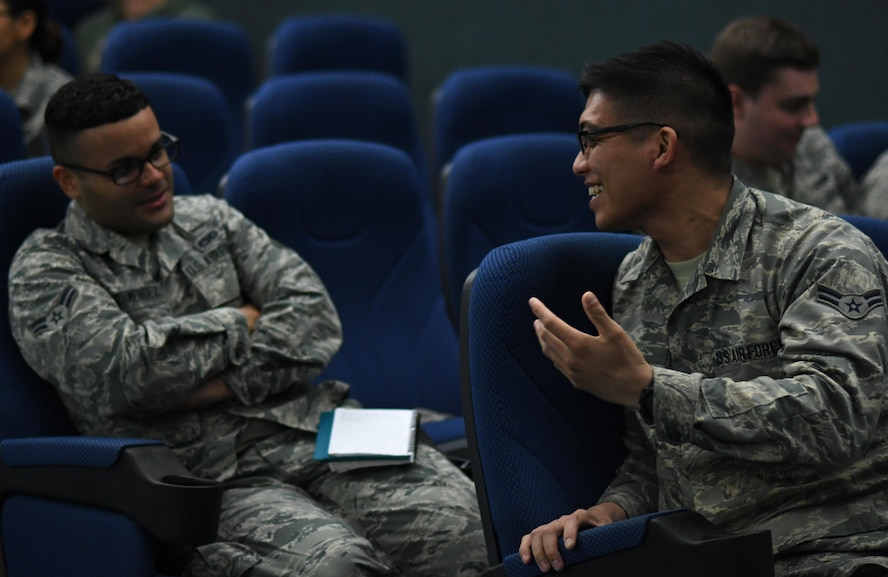 U.S. Air Force Airmen 1st Class Joseph Perez-Mendez, left, and Marc Ruiz, right, from the 51st Logistics Readiness Squadron, participate in a listening exercise during a Profession of Arms Center of Excellence seminar at Osan Air Base, Republic of Korea, March 20, 2017. The seminar focused on self-improvement lessons like effective communication techniques, improving relationships and the importance of knowing your people. (U.S. Air Force photo by Staff Sgt. Alex Fox Echols III/Released)