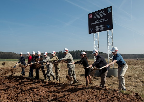 Base leadership, U.S. Army Corps of Engineers and local government and construction officials participated in a ground breaking ceremony at the future site of the middle/high school on Spangdahlem Air Base, Germany, Mar. 16, 2017. The school is estimated completion time is summer of 2019. (U.S. Air Force photo by Tech. Sgt. Chad Warren)