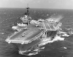 The U.S. Navy aircraft carrier USS Independence (CV-62) at sea during the later 1980s or early 1990s.
