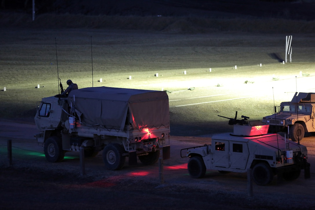 Vehicle gunnery crews line up in their firing order ahead of a night live-fire gunnery qualification during the Operation Cold Steel exercise conducted at Fort McCoy, Wisconsin, Mar. 20, 2017. Operation Cold Steel is the U.S. Army Reserve's first large-scale live-fire training and crew-served weapons qualification and validation exercise. Cold Steel plays a critical role in ensuring that America's Army Reserve units and Soldiers are trained and ready to deploy on short-notice and bring combat-ready and lethal firepower in support of the Total Army and Joint Force partners anywhere in the world. In support of the Total Army Force, First Army Master Gunners participated in Cold Steel to provide expertise in crew level gunnery qualifications, and to develop Vehicle Crew Evaluator training, preparing units here and when they return to their home stations to conduct crew served weapons training and vehicle crew gunnery at the unit-level. 475 crews with an estimated 1,600 Army Reserve Soldiers will certify in M2, M19 and M240 Bravo gunner platforms across 12-day rotations through the seven-week exercise.  (U.S. Army Reserve photo by Master Sgt. Anthony L. Taylor)