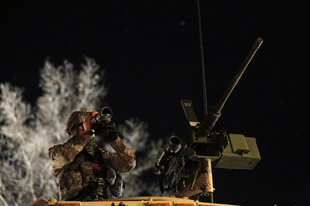 Pvt. Sean Bourque, Petroleum Supply Specialist assigned to the 786th Quartermaster Company, Provo, Utah, views the firing range through a thermal weapon sight ahead of a night live-fire gunnery qualification during the Operation Cold Steel exercise conducted at Fort McCoy, Wisconsin, Mar. 20, 2017. Operation Cold Steel is the U.S. Army Reserve's first large-scale live-fire training and crew-served weapons qualification and validation exercise. Cold Steel plays a critical role in ensuring that America's Army Reserve units and Soldiers are trained and ready to deploy on short-notice and bring combat-ready and lethal firepower in support of the Total Army and Joint Force partners anywhere in the world. In support of the Total Army Force, First Army Master Gunners participated in Cold Steel to provide expertise in crew level gunnery qualifications, and to develop Vehicle Crew Evaluator training, preparing units here and when they return to their home stations to conduct crew served weapons training and vehicle crew gunnery at the unit-level. 475 crews with an estimated 1,600 Army Reserve Soldiers will certify in M2, M19 and M240 Bravo gunner platforms across 12-day rotations through the seven-week exercise.  (U.S. Army Reserve photo by Master Sgt. Anthony L. Taylor)