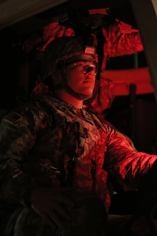 Army Reserve Sgt. Tyson Howes, assigned to the 786th Quartermaster Company, Provo, Utah, stands by with his gunnery crew in their firing order ahead of a night live-fire gunnery qualification during the Operation Cold Steel exercise conducted at Fort McCoy, Wisconsin, Mar. 20, 2017. Operation Cold Steel is the U.S. Army Reserve's first large-scale live-fire training and crew-served weapons qualification and validation exercise. Cold Steel plays a critical role in ensuring that America's Army Reserve units and Soldiers are trained and ready to deploy on short-notice and bring combat-ready and lethal firepower in support of the Total Army and Joint Force partners anywhere in the world. In support of the Total Army Force, First Army Master Gunners participated in Cold Steel to provide expertise in crew level gunnery qualifications, and to develop Vehicle Crew Evaluator training, preparing units here and when they return to their home stations to conduct crew served weapons training and vehicle crew gunnery at the unit-level. 475 crews with an estimated 1,600 Army Reserve Soldiers will certify in M2, M19 and M240 Bravo gunner platforms across 12-day rotations through the seven-week exercise. 