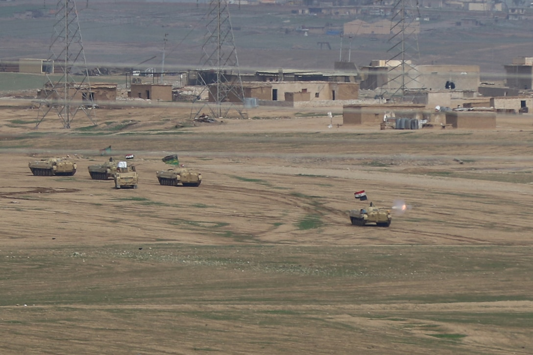 Elements of the 9th Iraqi Army Division, supported by Combined Joint Task Force-Operation Inherent Resolve, conduct an attack on ISIS defenses on the western edge of Mosul, Iraq, March 19, 2017. CJTF-OIR is the global Coalition to defeat ISIS in Iraq and Syria. (U.S. Army photo by Staff Sgt. Jason Hull)