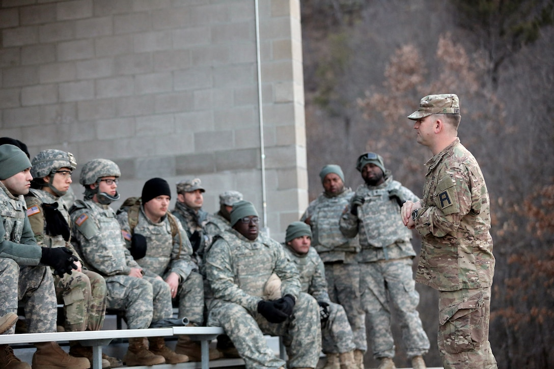 Sgt. 1st Class Larry McCracken, right, First Army Master Gunner assigned to 3-340th Training Support Battalion, 181st Infantry Brigade, conducts a brief to vehicle gunnery crews ahead of a night live-fire gunnery qualification during the Operation Cold Steel exercise conducted at Fort McCoy, Wisconsin, Mar. 20, 2017. Operation Cold Steel is the U.S. Army Reserve's first large-scale live-fire training and crew-served weapons qualification and validation exercise. Cold Steel plays a critical role in ensuring that America's Army Reserve units and Soldiers are trained and ready to deploy on short-notice and bring combat-ready and lethal firepower in support of the Total Army and Joint Force partners anywhere in the world. In support of the Total Army Force, First Army Master Gunners participated in Cold Steel to provide expertise in crew level gunnery qualifications, and to develop Vehicle Crew Evaluator training, preparing units here and when they return to their home stations to conduct crew served weapons training and vehicle crew gunnery at the unit-level. 475 crews with an estimated 1,600 Army Reserve Soldiers will certify in M2, M19 and M240 Bravo gunner platforms across 12-day rotations through the seven-week exercise.  (U.S. Army Reserve photo by Master Sgt. Anthony L. Taylor)