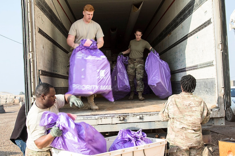 U.S. Army Soldiers from the 387th Postal Platoon, unload bags of mail in Taji, Iraq, on Feb. 15, 2017. Soldiers working in the mail room can process roughly 30 to 450 bags of mail weekly. (U.S. Army photo by Sgt. Cesar E. Leon)