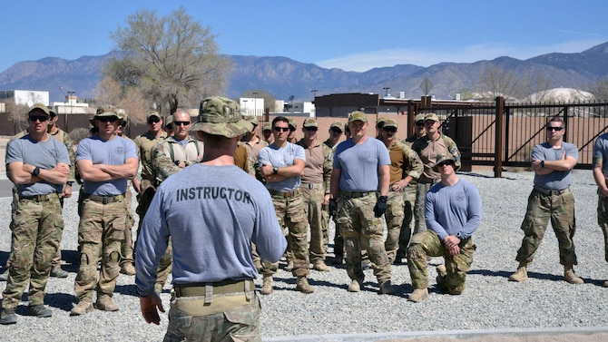 Major Brian Carey, 351st Battlefield Airman Training Squadron's director of operations, delivers a safety brief to assault course participants March 16 at Kirtland Air Force Base. Carey provided safety briefs for all obstacles, including some demonstrations. The course includes challenges like low crawls, rope and rock climbing, and jumping over a high wall, and will be used in training BATS students. (U.S. Air Force Photo/Senior Airman Chandler Baker)