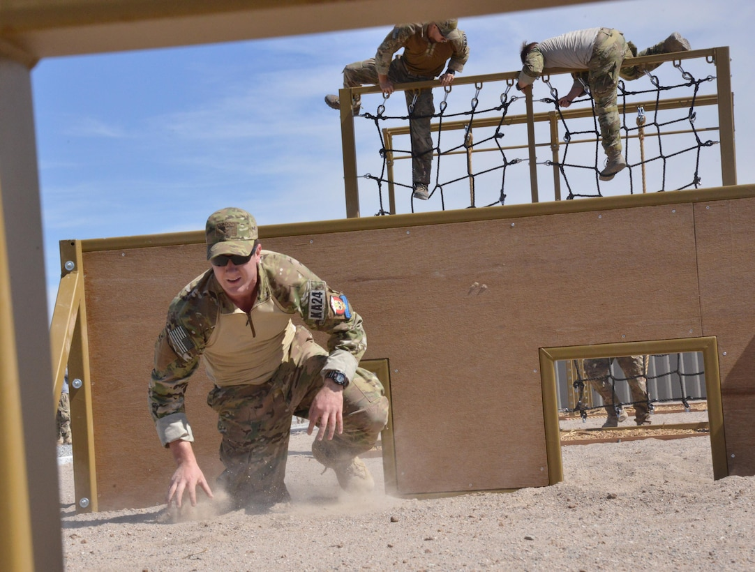 Pararescue trainees from the 351st Battlefield Airmen Training Squadron test the unit's new assault course March 17 at Kirtland. The course includes challenges like low crawls, rope and rock climbing, and jumping over a high wall, and will be used in training BATS students. (U.S. Air Force Photo/Senior Airman Chandler Baker)