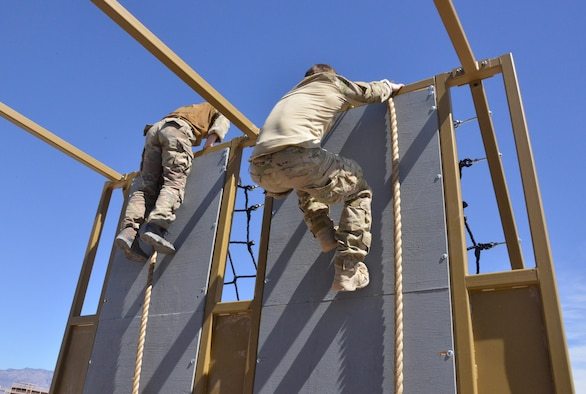 Pararescue trainees from the 351st Battlefield Airmen Training Squadron test the unit's new assault course March 16 at Kirtland. The course includes challenges like low crawls, rope and rock climbing, and jumping over a high wall, and will be used in training BATS students.