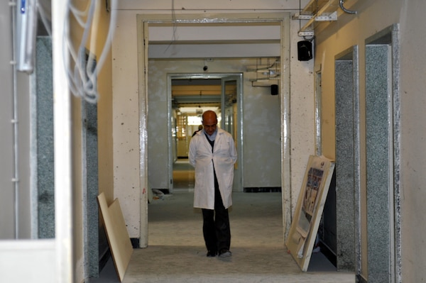 KABUL, Afghanistan (March 8, 2017) — A doctor walks the corridors of Kabul National Military Hospital as the facility undergoes repairs and improvements. The KNMH is primed to emerge from a recent tragic attack as a state-of-the-art facility for patient care, continuing a long legacy as the biggest and finest military hospital in service of the Afghan National Defense and Security Forces.