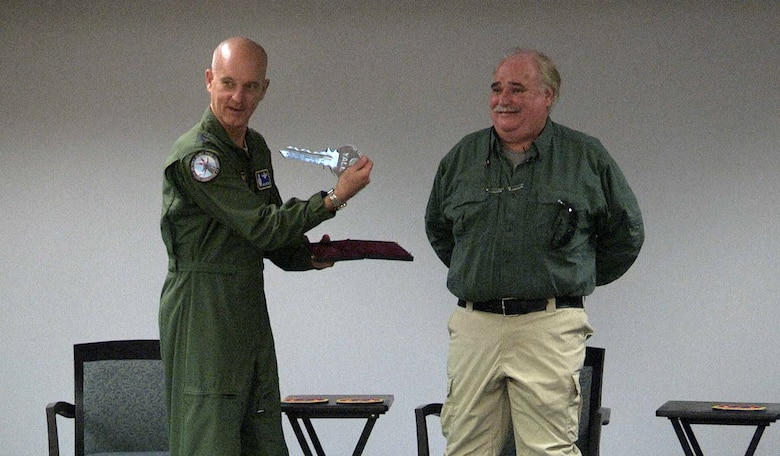 Local business owner, Danny Thompson, donates a ceremonial Titan One missile launch key to the Air Force, March 8, 2017. Global Strike Command vice commander, Maj. Gen. Michael Fortney, accepted the key, which will be taken to the Barksdale Global Power Museum. (U.S. Air Force photo by Staff Sgt. Anthony Flores)