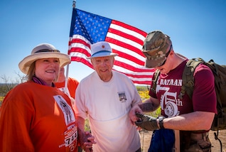 Army Spc. Michael Cole, right, checks retired Army Col. Ben Skardon vital signs at the eight-mile mark during the Bataan Memorial Death March at White Sands Missile Range, N.M., March 19, 2017. Cole is a medic. Army photo by Staff Sgt. Ken Scar
