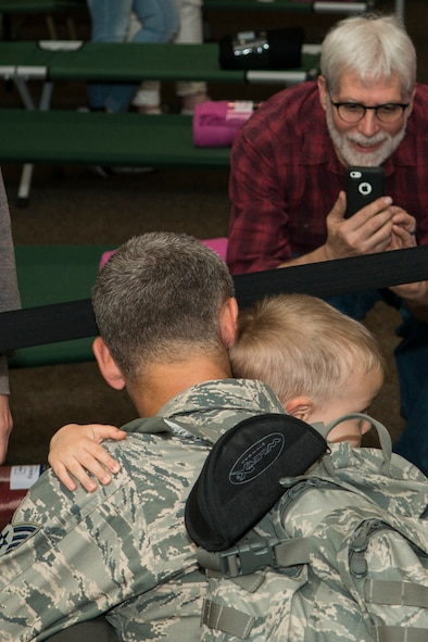 A U.S. Air Force Airman returns home from a six-month deployment on Mar. 20, 2017, Barksdale Air Force Base, La. The Airman deployed to Southwest Asia in support of Operations Inherent Resolve and Freedom's Sentinel. (U.S. Air Force photo by Master Sgt. Greg Steele/released)