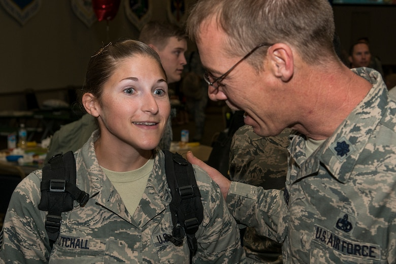 U.S. Air Force Staff Sgt. Amber Cutchall is welcomed home by Lt. Col. Warren Crabtree, 707th Maintenance Squadron (MXS) commander, after returning home from a six-month deployment on Mar. 20, 2017, Barksdale Air Force Base, La.  Cutchall is assigned to the Air Force Reserve Command's 707th MXS and deployed to Southwest Asia in support of Operations Inherent Resolve and Freedom's Sentinel. (U.S. Air Force photo by Master Sgt. Greg Steele/released)