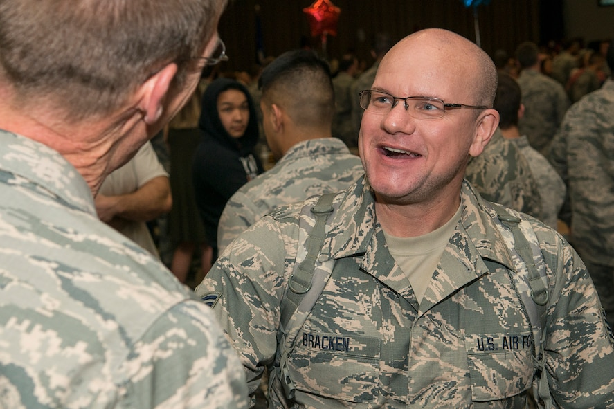 U.S. Air Force Staff Sgt. William Bracken is welcomed home by Lt. Col. Warren Crabtree, 707th Maintenance Squadron (MXS) commander, after returning home from a six-month deployment on Mar. 20, 2017, Barksdale Air Force Base, La.  Bracken is assigned to the Air Force Reserve Command's 707th MXS and deployed to Southwest Asia in support of Operations Inherent Resolve and Freedom's Sentinel. (U.S. Air Force photo by Master Sgt. Greg Steele/released)