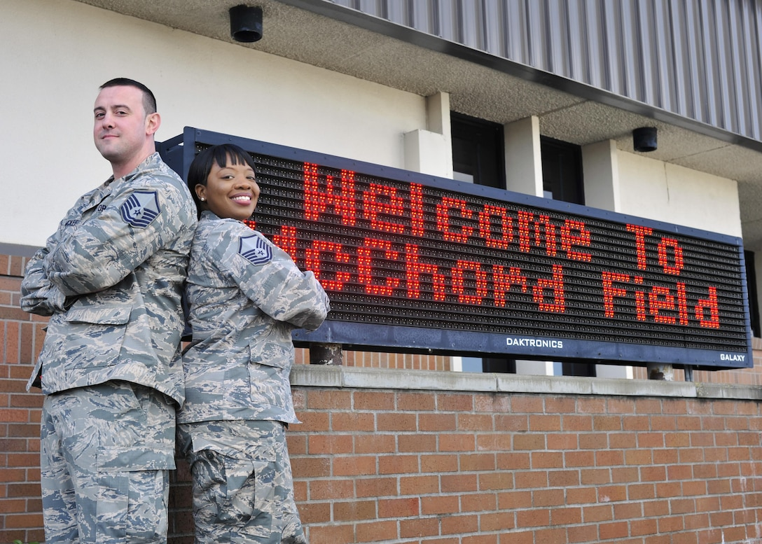 Master Sgt. Theodore (T.J.) McKee, 62nd Aerial Port Squadron passenger service operations NCOIC, and wife, Master Sgt. Tiffany McKee, 627th Logistics Readiness Squadron logistics plans superintendent, pose for a photo on the McChord Field flightline at Joint Base Lewis-McChord, Wash., March 16, 2017. Separated by military orders for more than half of their 4-year marriage, the McKees reunited at JBLM in early 2016 and ended the year as Team McChord Annual Award winners in their respective categories of NCO and SNCO. (U.S. Air Force photo/Staff Sgt. Whitney Amstutz)