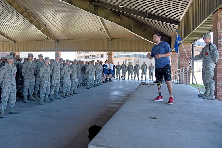 Austin Weed, 312th Training Squadron guest speaker, speaks to a group of students at one of the training group pavilions on Goodfellow Air Force Base, Texas, March 17, 2017. Weed lost his leg in a car crash and through his determination was able to get well enough to play basketball his senior year of high school. (U.S. Air Force photo by Staff Sgt. Joshua Edwards/Released)