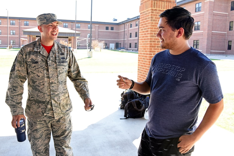 U.S. Air Force Senior Master Sgt. David Clark, 312th Training Squadron first sergeant, and Austin Weed, 312th TRS guest speaker, talk after Weed's resiliency speech to a group of students at one of the training group pavilions on Goodfellow Air Force Base, Texas, March 17, 2017. Clark asked Weed to come to base to share the story of how he overcame the loss of his leg. (U.S. Air Force photo by Staff Sgt. Joshua Edwards/Released)
