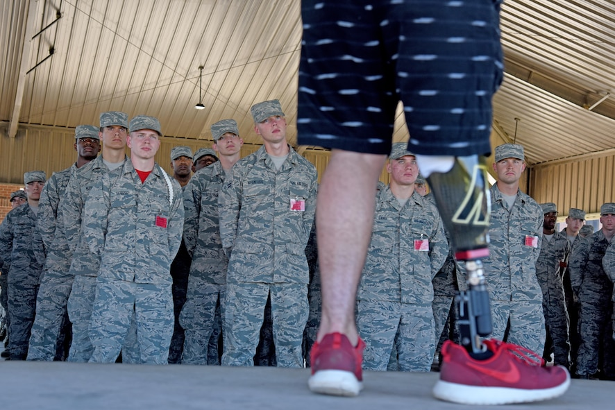 Austin Weed, 312th Training Squadron guest speaker, speaks to a group of students at one of the training group pavilions on Goodfellow Air Force Base, Texas, March 17, 2017. Weed, who lost his leg in a car crash, spoke about the importance of never giving up and friendship. (U.S. Air Force photo by Staff Sgt. Joshua Edwards/Released)