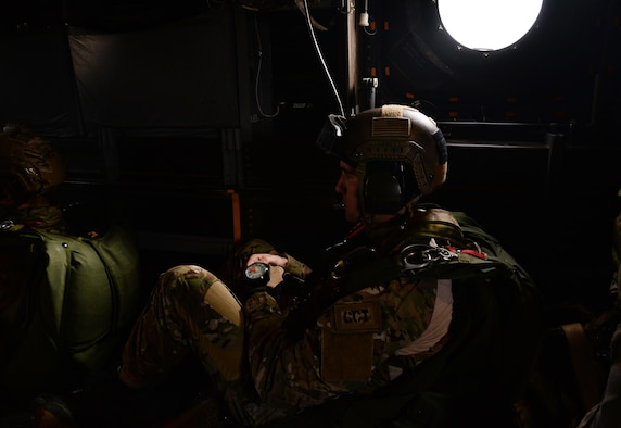 A U.S. Air Force Air Commando, assigned to the 321st Special Tactics Squadron anticipates a military free fall from a CV-22 Osprey March 17, 2017, over RAF Mildenhall, England. The exercise also included Air Commandos performing free falls from an MC-130J Commando II and allows flight crew and 321st STS members to practice safely deploying from aircraft to reach designated drop zones. (U.S. Air Force photo by Senior Airman Justine Rho)